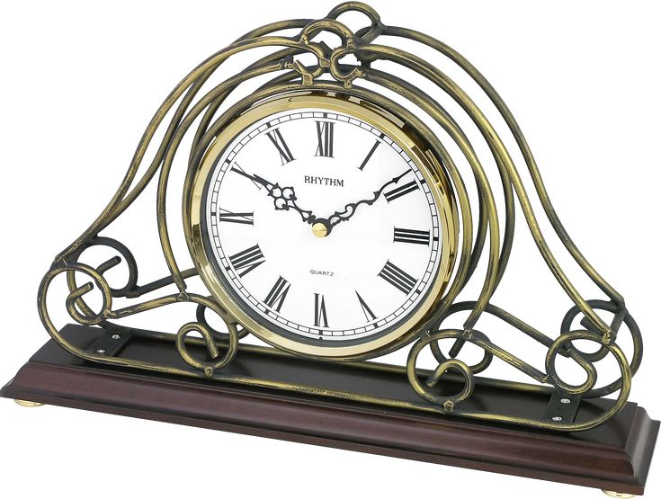 -Rhythm Table Clock  -wooden Base  -metal Frame  -Time ONLY  -Batteries: 1 standard AA  -made in japan  -2 years guarantee