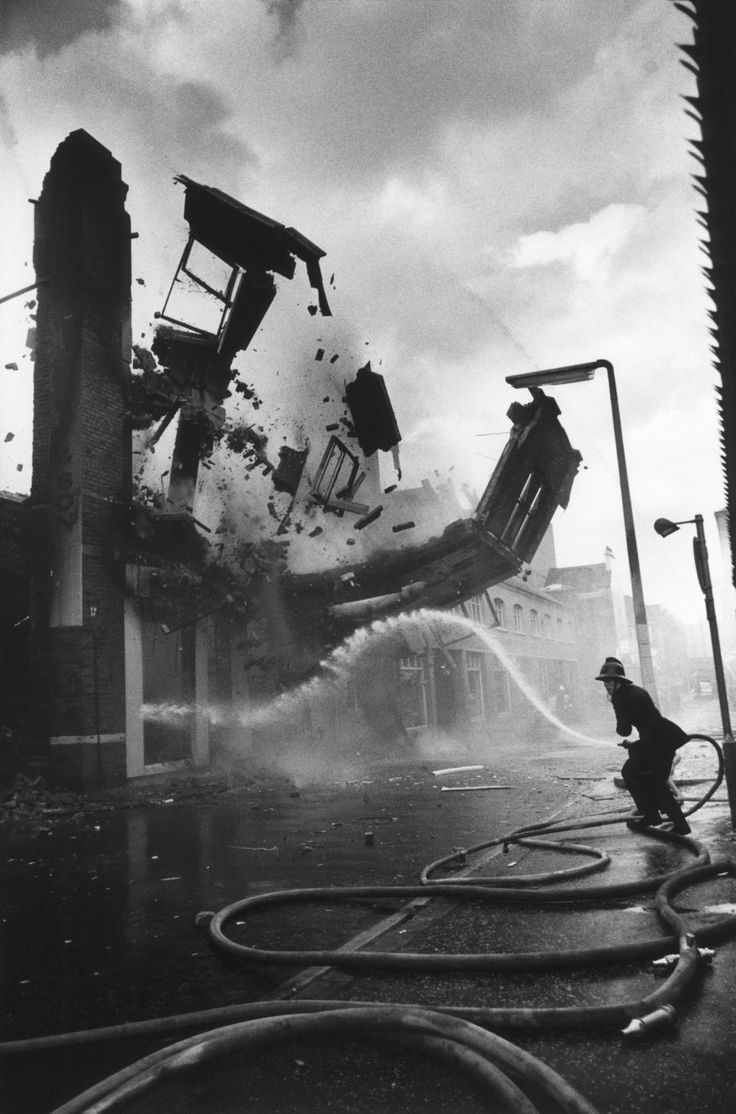 A wall crumbles down after having been set on fire, presumably by the IRA, Belfast, Northern Ireland, 1972