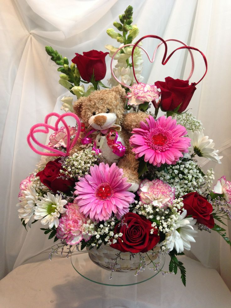 The perfect combination of roses, gerbera daisies, carnations, snap dragons, daisies & a sweet 'lil bear arranged in a basket, ready to tell your sweetie how much you care!