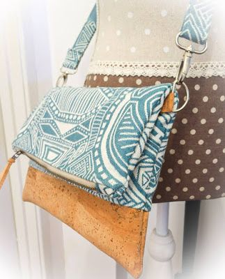 Adding a strap to your fold over party clutch//Tutorial from LTB Designs//Pattern from Little Moo Designs.