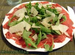 CARPACCIO: thin uncooked beaf meat slices, oil, pepper, salt, lemon juice, parmesan flakes and salad