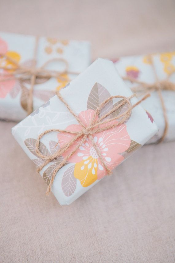 handmade wedding favor wrapped soaps tied with twine and kraft thank you tag