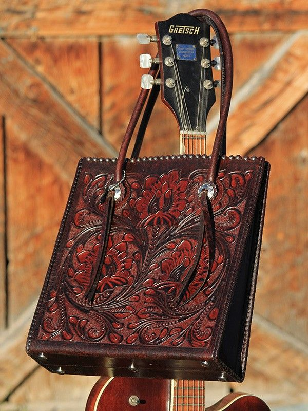 Saddle tooled bag