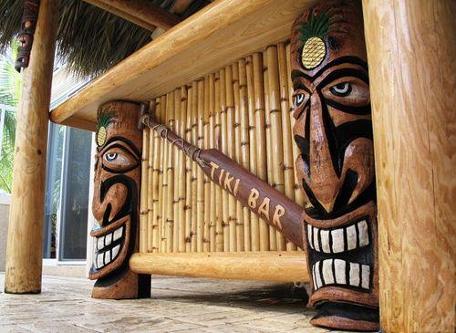 Tiki bar with tiki totems