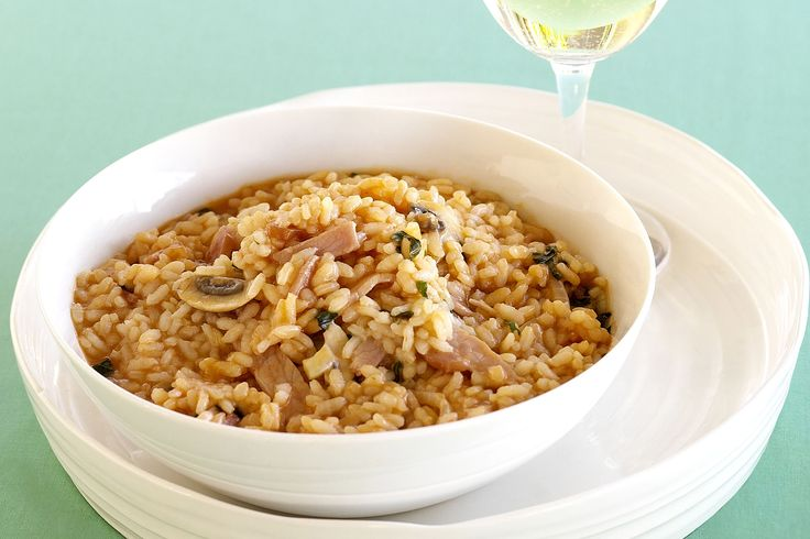 Taste.com.au members love this creamy risotto with bacon, mushroom and tomatoes. Try it tonight and let us know what you think.