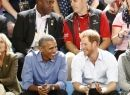 Britain's Prince Harry and former U.S. President Barack Obama watch a wheelchair basketball event during the Invictus Games in Toronto, Ontario, Canada September 29, 2017. REUTERS/Mark Blinch