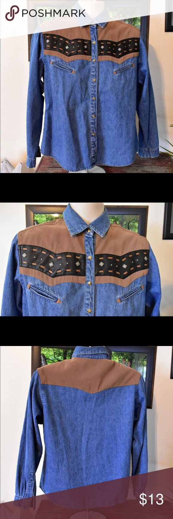 """Vintage Wrangler Denim Button Down w/Conchos L Vintage 80s women's Wrangler western shirt Cotton, polyester and spandex excellent condition, no flaws Marked a women's size L Please refer to measurements for a perfect fit. Shoulders 17"""" Sleeves 23"""" Chest 43"""" Waist 42"""" Length 25"""" Wrangler Tops Button Down Shirts"""