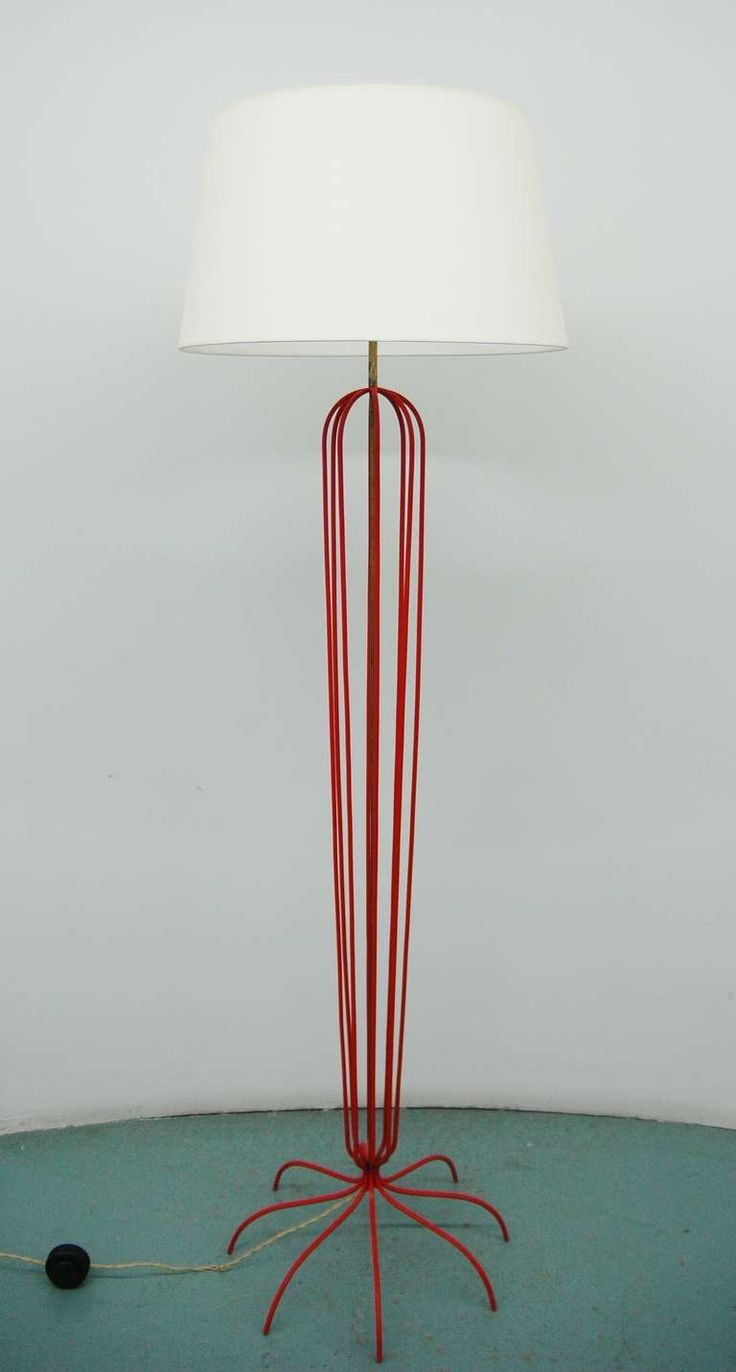 A Red Metal Floor Lamp In The Manner Of Jean Royere | From a unique collection of antique and modern floor lamps  at https://www.1stdibs.com/furniture/lighting/floor-lamps/
