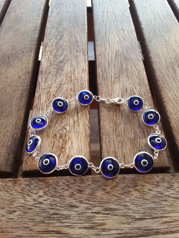 Check out this item in my Etsy shop https://www.etsy.com/listing/205440028/glass-evil-eye-bracelet-dark-blue