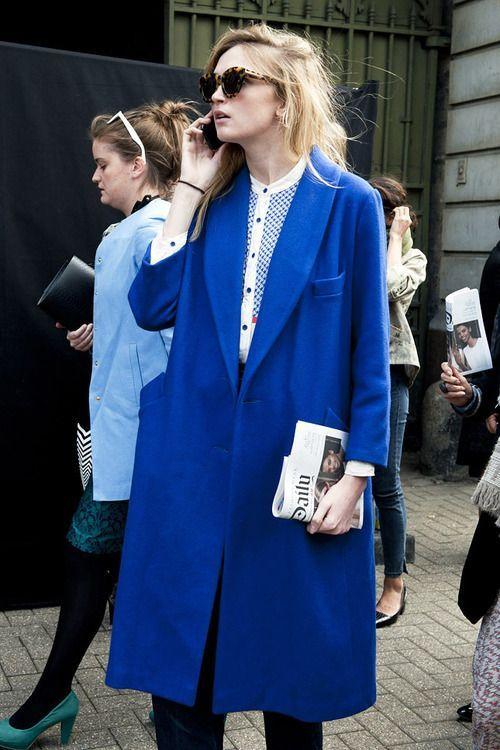 Blue coat + tortoise shades.