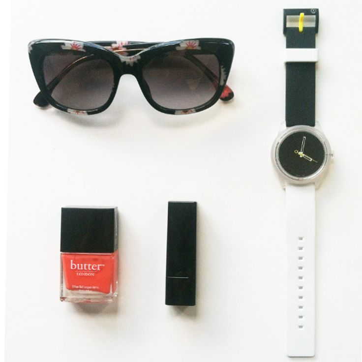 All of the essentials: bold polish, patterned sunglasses, natural lip, and Q&Q.
