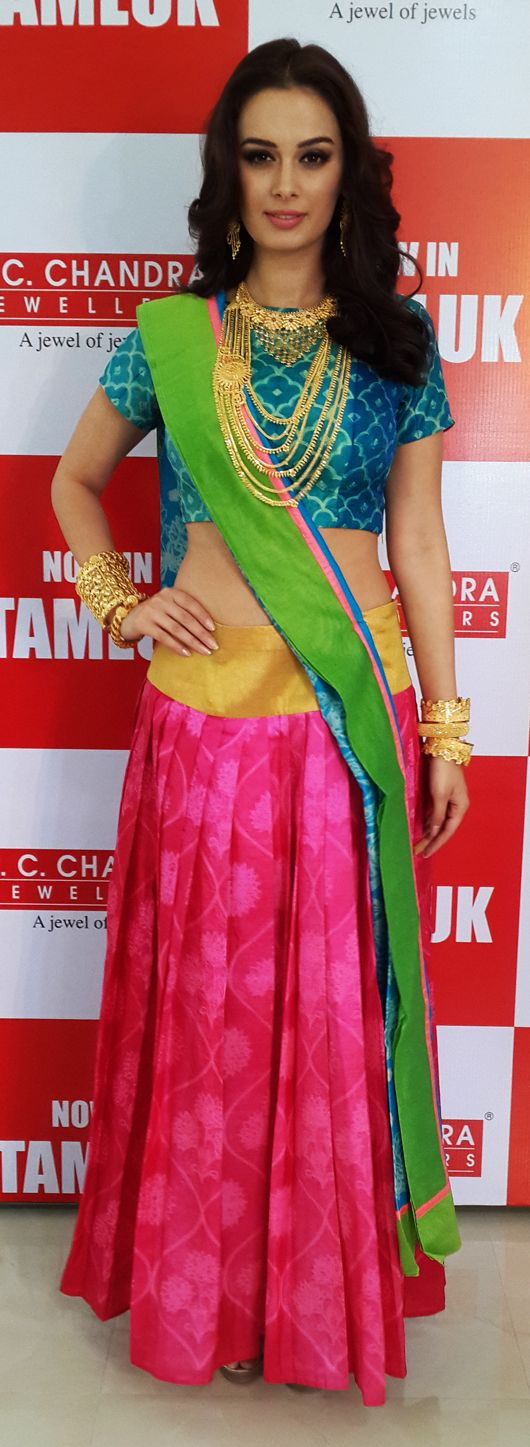 The Bollywood siren wears a pleated ghagra-choli by Swati Vijaivargie