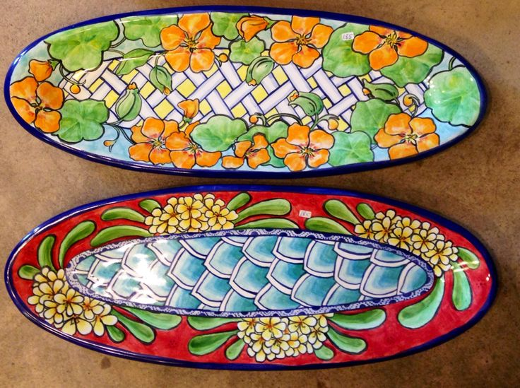 Two long skinny platters painted by Tessa at Damariscotta Pottery