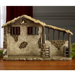 "Lighted Nativity Stable. Designed to capture the reality of the humble stable where Jesus was born - from the palm thatched roof to the dove peering down on the manger below - this unique and intricately detailed stable completes the Real Life Nativity Crèche. Included is a light that fills the interior with a soft glow and shines down on the manger below. It measures 15"" x 9?"" x 4¼"" and batteries are included.. Price: $69.98"