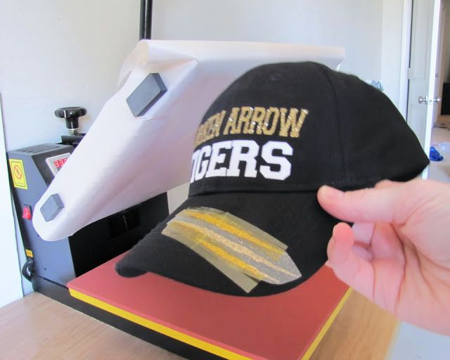Big things are happening around here today - 1) I have a tutorial for you on how to add heat transfer vinyl to hats and caps (without any special heat press attachments) and 2) we have a very special
