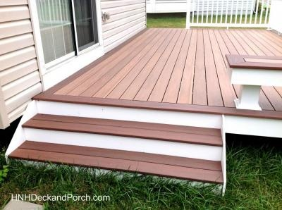 Vinyl Patio Deck With Wide Steps Using Wolf PVC Decking Amberwood Flooring  And Rosewood Border.