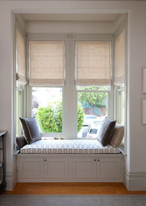 motorized roman shades in a bay window and built in window seat traditional roman blinds san francisco stitch custom furnishings