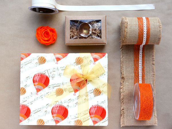 Natural tones with pops of orange..gift packaging with personality