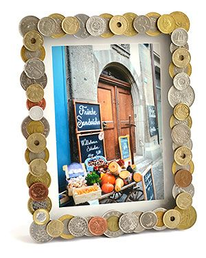 Kodak Moments:  - Show off your travel photos in foreign coin frame.