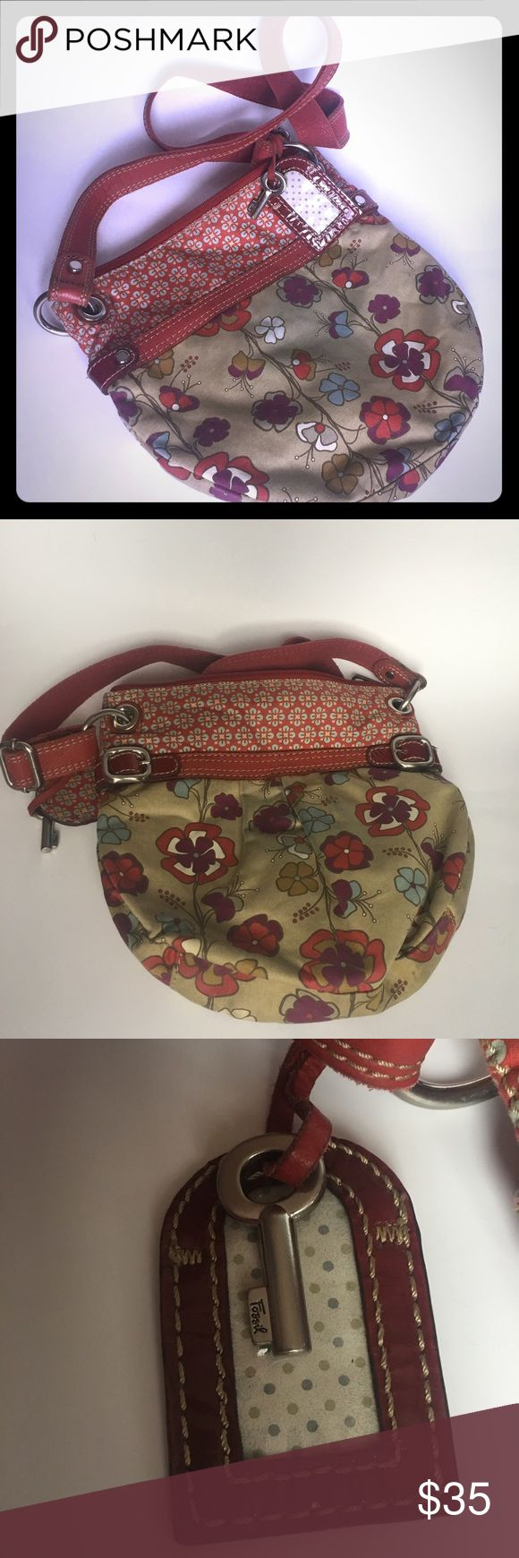 Fossil purse Fossil floral purse needs a good wash grate hobo bag lots of room inside is in good shape has fossil key and name tag Fossil Bags Hobos