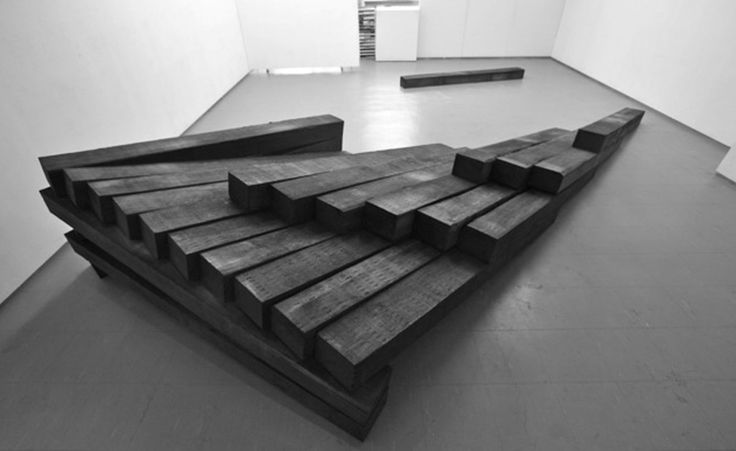 'Fallen Wing - Headless Scenery', 2015, by Noboru Takayama, is perhaps the most evocative piece of the show. Its wooden composition and elongated shape reminds of the Japanese wood railway ties which evoke, in turn, the tragic collective memory of soot-stained casualties