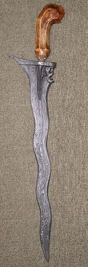 The kris or keris is a prized asymmetrical dagger most strongly associated with the culture of Indonesia, but also indigenous to Malaysia, Thailand and Brunei. It is known as kalis in the southern Philippines. The kris is famous for its distinctive wavy blade, but in the past, most had straight blades.