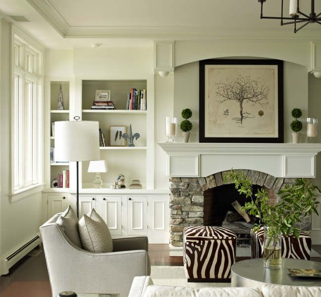 Stone Fireplace Built In Bookcase And Arched Wood Mantel And The Zebra Ottomans