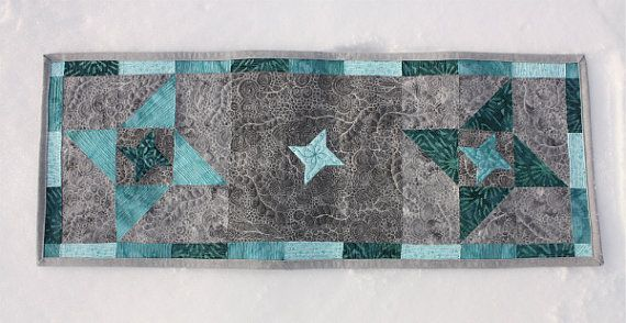 This beautiful mini quilt is perfect as either wall art or as a table runner. The intricate quilting is certain to attract attention.