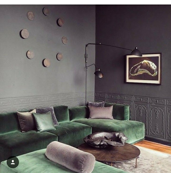 Maybe one day we can upgrade to a sectional. For now, green sofa - dark grey walls. Brown & metal accents.