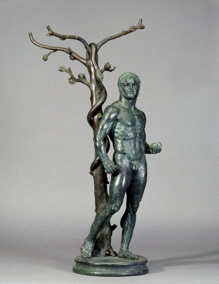Bronze group: Herakles at the tree of the Hesperides, holding three of the golden apples in his left hand. Behind him is the apple tree with the guardian serpent clinging around it. Culture/period Roman. Date 1stC Findspot: Byblos, temple