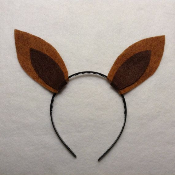 Kangaroo ears headband. Color options are endless and can be completely customized. I also have options with bows in my other listings. These are made