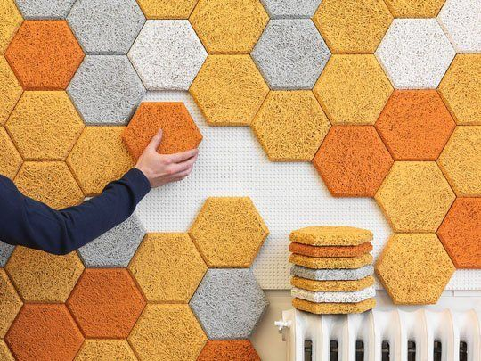 "Hexagon panels consist of modular pieces of colorful ""wood wool"" that comes from the company Träullit in Sweden. ""Wood Wool"" is a mixture of wood slivers, water and cement. The result is a material that is environmentally friendly, water resistant, and sound absorbent."