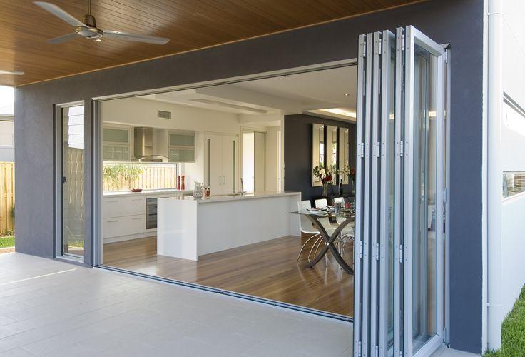 Wide aluminium bifold door and louvre window.