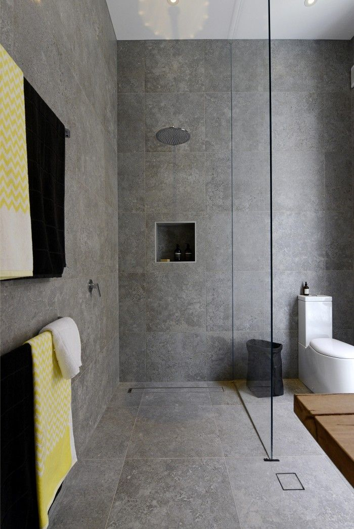 Love the grey tiles and the yellow touch of the towels. #bathroomsets #bathroomdecorideas