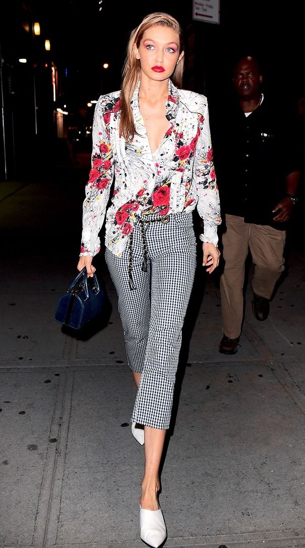Gigi Hadid looked feminine and polished as she stepped out for a late dinner in New York City. Hadid mixed prints like a pro and is inspiring us to wear colors we typically reserve for the day out after hours!