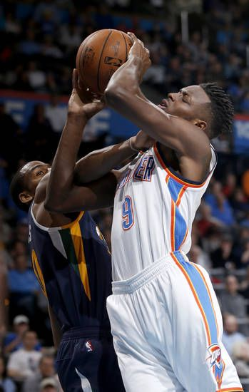 Oklahoma City's Jerami Grant (9) is fouled by Utah's Alec Burks (10) during an NBA basketball game between the Oklahoma City Thunder and the Utah Jazz at Chesapeake Energy Arena in Oklahoma City, Tuesday, Feb. 28, 2017. Photo by Bryan Terry, The Oklahoman