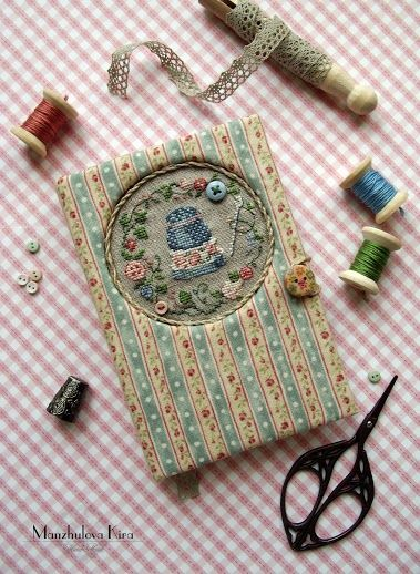 Sweet!! Handstitched notebook    (...cr...I have made little fabric-covered notebooks like this but put a velvet theorem in the circle....so cute....make the cover from matteboard and cloth....make a flap inside so you can slip the notebook in so that when it is used up, you can replace it...so cute)