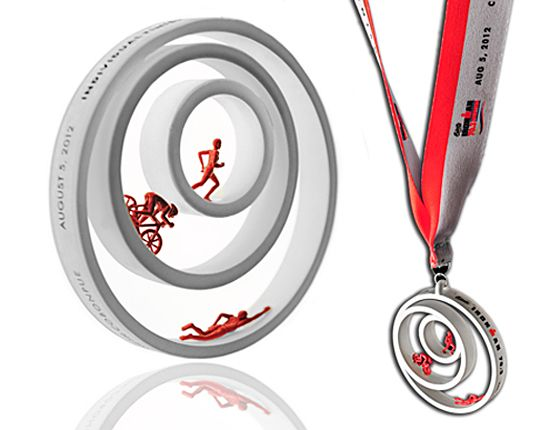 2012 Ironman 70.3 Philippines triathlon finisher medal designed by artist Kenneth Cobonpue.