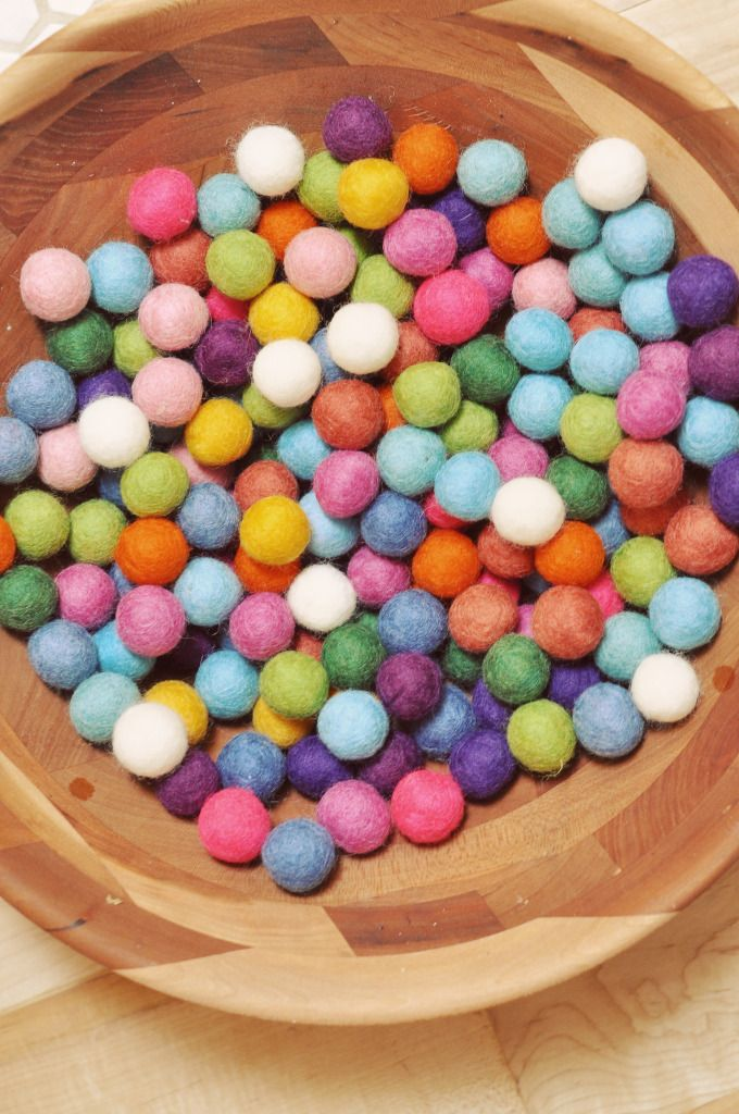 Make your own felt balls and then make a garland using this tutorial