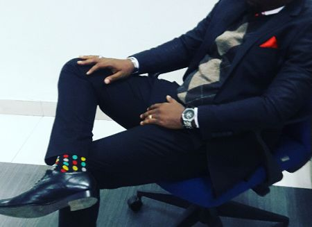 Model: Jack Imoh (Mr. Jack)   Photo Credit: Jack Imoh My Cold Monday Look Outfit: A black suit A white shirt An argyle sweater Multi coloured striped neck tie A black shoe A black belt A red pocket…