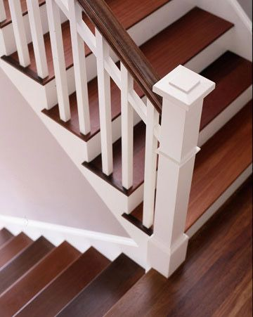 White-and-Wood Stairway - For traditional-style homes, the tightly tailored look of a classic white-and-wood tone stairwell is often the best choice. Here, simple, square baluster uprights are perked up with a line of white stringers running beneath the natural wood handrail.