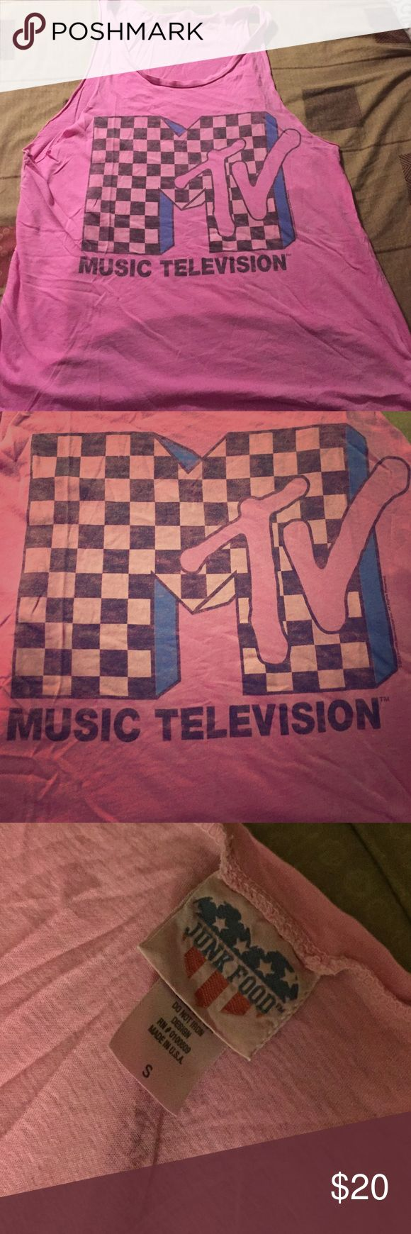 MTV Pink Muscle Tee Perfect to be worn over your strapless bra, bikini top, or sports bra. Either way, you're gonna be ready to beat the heat in a fashion-hip-cool pink muscle top with a faded-look (yes, it's meant to look faded) checkered MTV MUSIC TELEVISION logo. Size: Small Brand: JUNK FOOD.® Junk Food Clothing Tops Muscle Tees