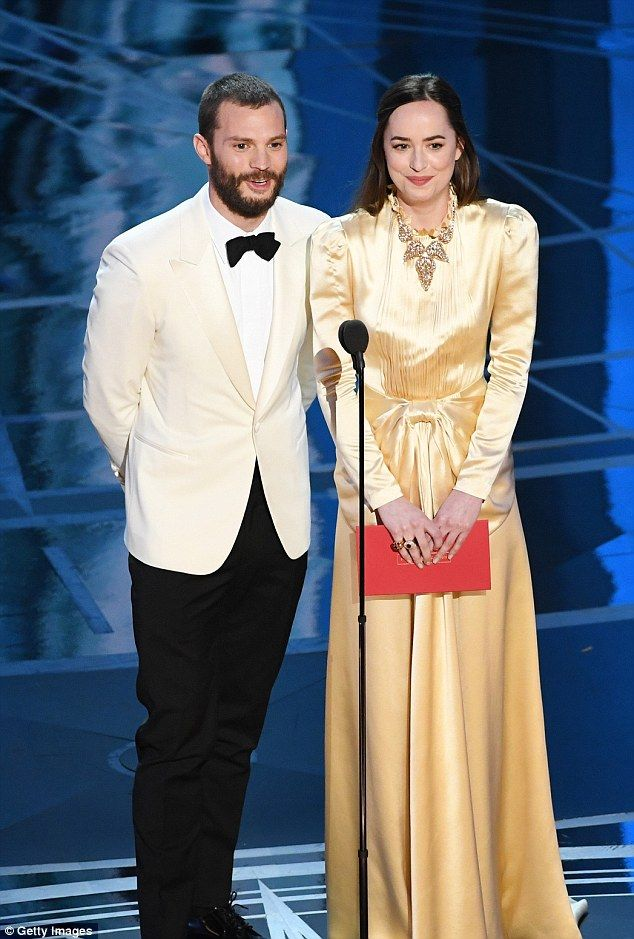 Dakota Johnson pays tribute to the Oscars in gold gown | Daily Mail Online