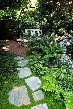 Seriously doesn't get much better than this! From the brick patio, rock garden ferns, hostas, garden path complete with trellis arch....I sooo want to do this in my yard!
