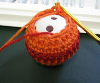 very cute crochet cat toy using practice golf balls