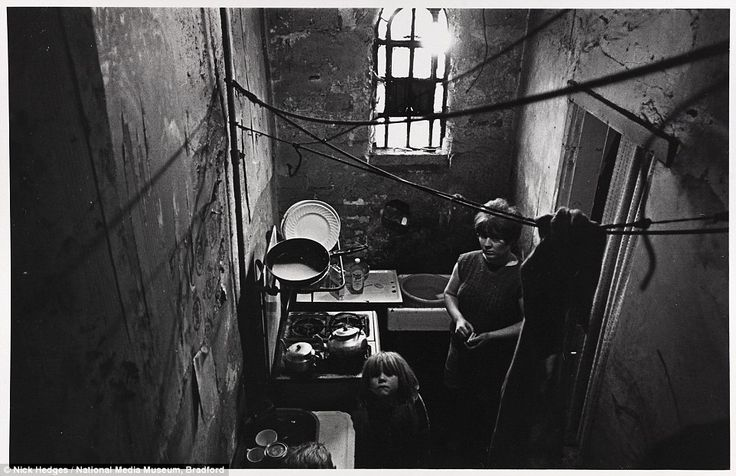 Hungry: A woman and her child look up from the kitchen of a council-owned property in a slum in Balsall Heath, Birmingham in November 1969. Above them a makeshift washing line is tied to the exposed water pipes attached to the peeling, damp-ridden walls in the dank room
