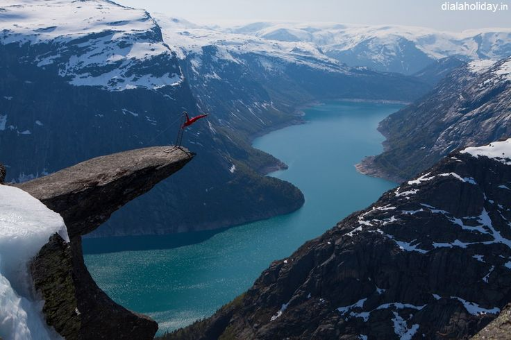 Trolltunga is a piece of rock that hangs out of the #mountain about 2,000 feet up in the air.  Enjoy this thrilling #destination in #Norway with #dialaholiday   #travel #destination