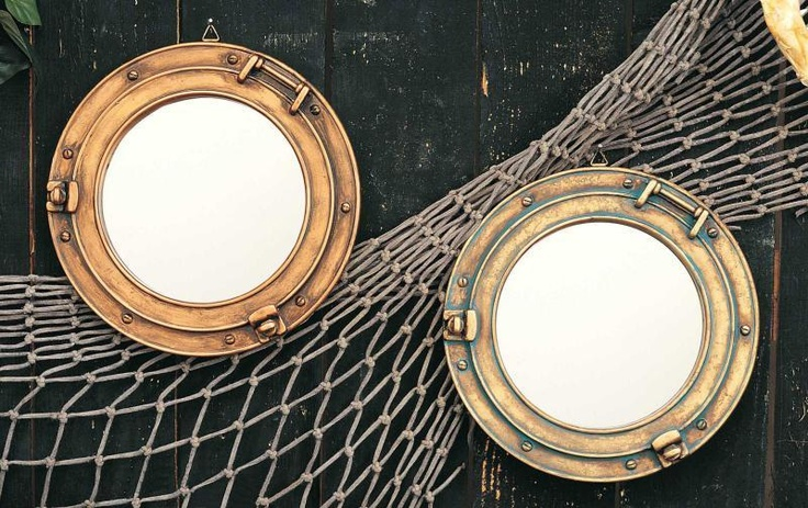 Shane's boat bathroom-Porthole Mirrors-love it with the fish net through them.