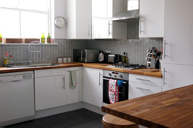 Love grey tile splashbacks wooden benchtop kitchen for Kitchen benchtop ideas