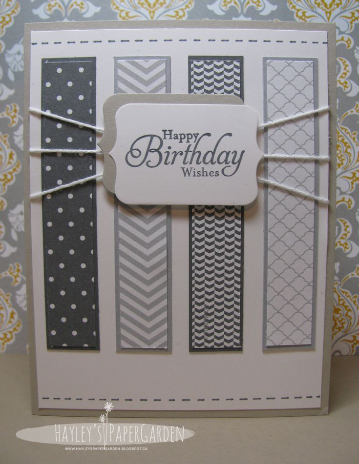 handmade birthday card from Hayley's Paper Garden ... shades of gray ... luv the matted strips of patterned papers in grays ... fun string treatment with triple strands attaching to to sentiment label ... clean lines ... great masculine card!